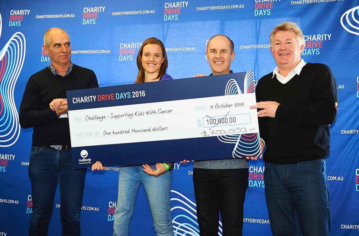Charity Drive Days donating cheque to Challenge charity